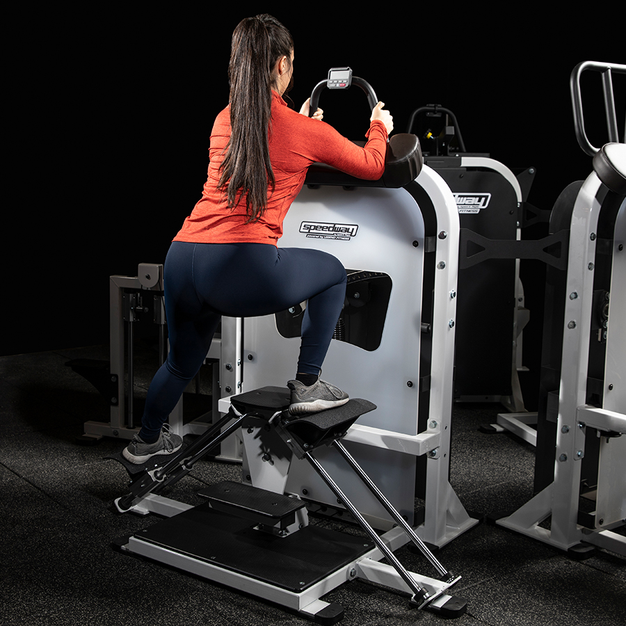 A photo of the Speedway Circuit A Train machine being used by a female athlete. It is Legend Fitness item 7051. It was developed by Andre Agassi and Gil Reyes.