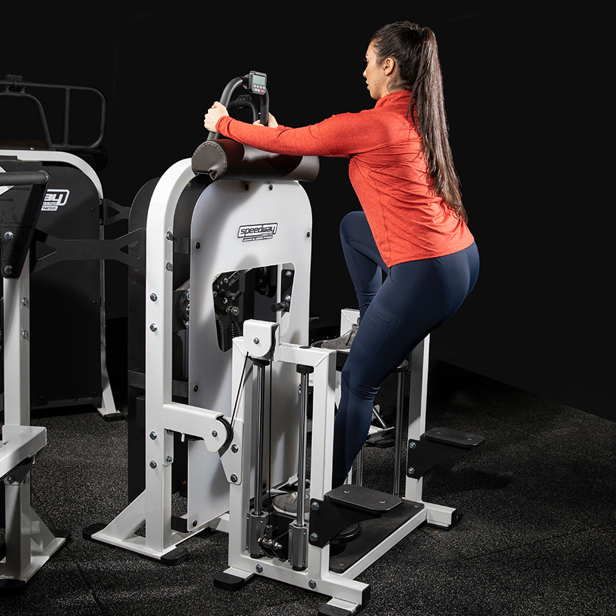 A photo of the Speedway Circuit Ground & Pound machine being used by a female athlete. It is Legend Fitness item 7052. It was developed by Andre Agassi and Gil Reyes.